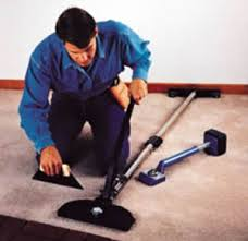 carpet stretcher. installer using a carpet stretcher
